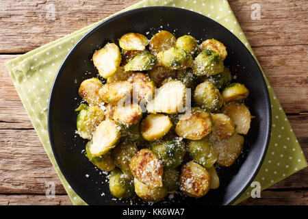 roasted brussels sprouts with garlic and Parmesan cheese on a plate close-up on the table. horizontal top view from - Stock Photo