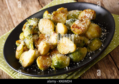 roasted brussels sprouts with garlic and Parmesan cheese on a plate close-up on the table. horizontal - Stock Photo