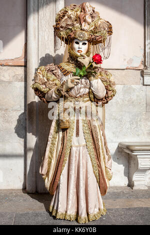 A woman dressed up for the Carnival in Venice, Italy - Stock Photo