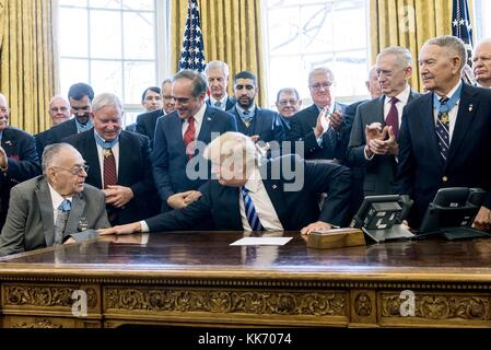 U.S. President Donald Trump meets with Medal of Honor Recipients in the Oval Office at the White House March 24, - Stock Photo