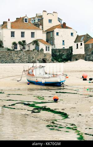 A picturesque corner of the old boat harbour of St. Ives on the north coast of Cornwall, England, UK. Low tide - Stock Photo