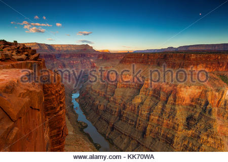 The full moon rises over the Grand Canyon and Colorado River in this view from the Tuweep Overlook (also spelled - Stock Photo