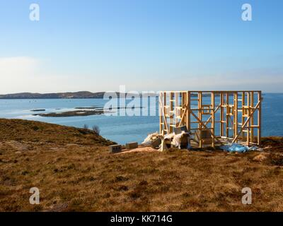 Building of bird observation tower. Wooden construction of lookout tower for counting towing birds. - Stock Photo