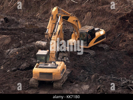 Two excavators on the construction of the new facility. - Stock Photo