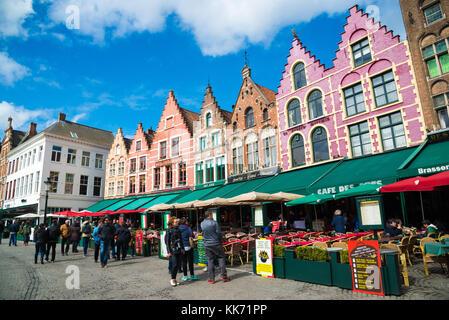 Bruges, Belgium - April 17, 2017: Tourists in north side of Grote Markt - Market Square of Bruges, Brugge, with - Stock Photo