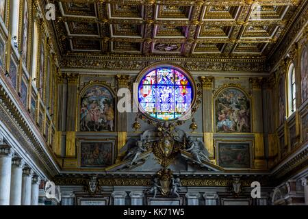 Ceiling And rose stained glass window of Basilica Di Santa Maria Maggiore Church in Rome, Italy, Europe - Stock Photo