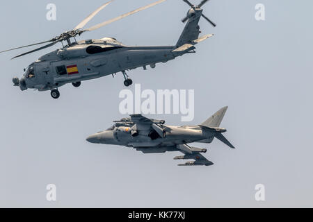 MOTRIL, GRANADA, SPAIN-JUN 11: Aircraft AV-8B Harrier Plus and  helicopter SH-60 Seahawk taking part in an exhibition - Stock Photo