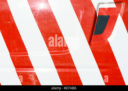 Red and white door markings for safety painted on a vehicle exterior - Stock Photo