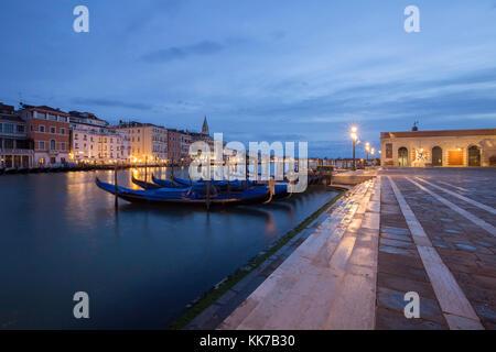 Pre-dawn Blue Hour at Santa Maria della Salute, Dorsoduro, Venice looking down the Grand Canal towards St Mark's - Stock Photo