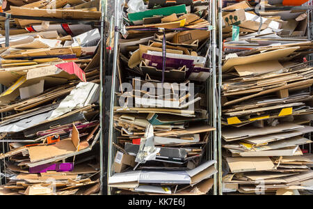 Stack of paper for recycling in metal containers - Stock Photo