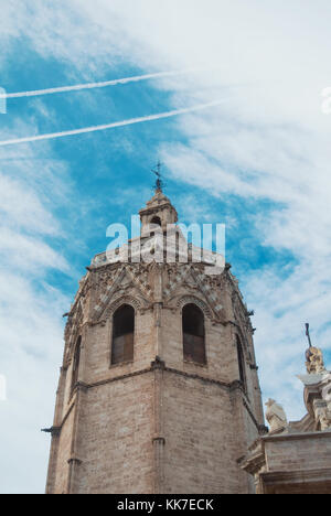 El Miguelete (El Micalet), the gothic bell tower of Valencia Cathedral in Spain and cloudy sky at the background. - Stock Photo