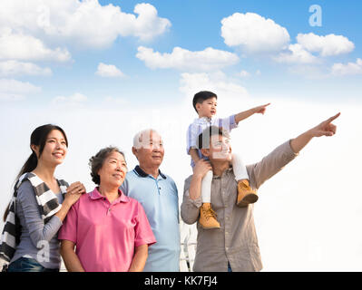 three generations family having fun together outdoors - Stock Photo
