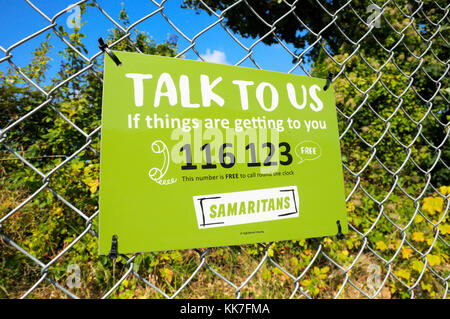 Samaritans sign with telephone helpline number - Stock Photo