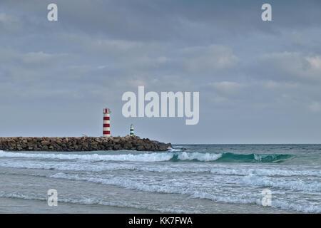 Light tower in Ilha Deserta (Desert Island) in Faro, Algarve, Portugal - Stock Photo