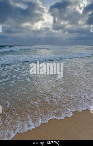 Cloudy scene in Ilha Deserta (Desert Island). Faro, Algarve, Portugal - Stock Photo