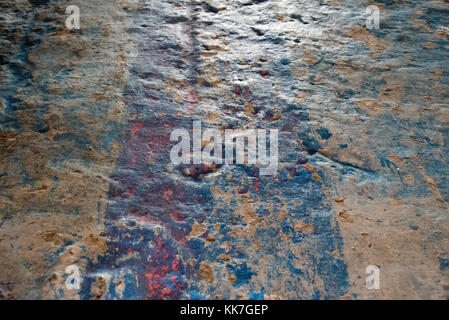 Polished plaster wall - showing aged pain finish - worn & dented over time - Stock Photo
