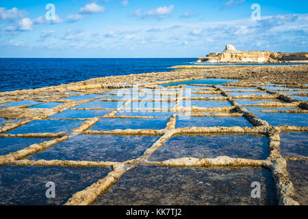 Salt evaporation ponds on Gozo island, Malta - Stock Photo