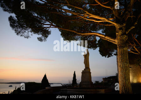 Dusk over Cannes from Town Square beside the Church of Notre-Dame d'Esperance with Virgin Mary, Le Suquet Old Town, - Stock Photo