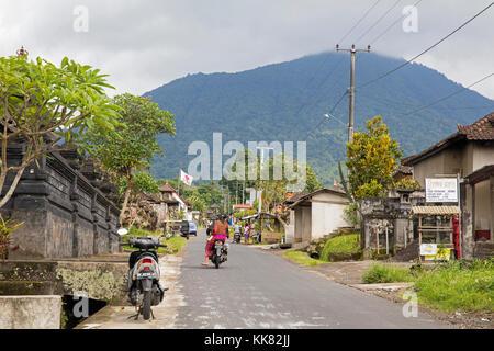 Street scene in the rural village Munduk, Buleleng regency, Bali, Indonesia - Stock Photo