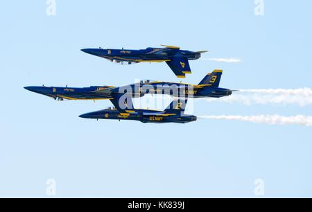 The US Navy Flight Demonstration Squadron, the Blue Angels, diamond pilots perform the Double Farvel maneuver at - Stock Photo