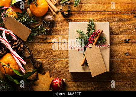 Christmas background with oranges, candy canes and decorations - Stock Photo