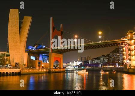 Night view of the Bilbao estuary with the La Salve Bridge. - Stock Photo