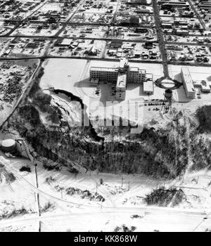 Overhead view of a landslide from the March 27, 1964 Alaska earthquake. The landslide occurred next to this hospital - Stock Photo