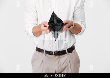 Close up portrait of a man showing empty wallet isolated over white background - Stock Photo