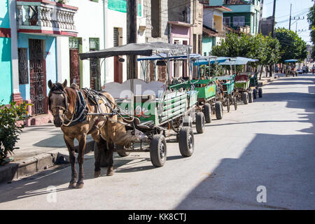 Horse carriage taxis in a row in Cienfuegos, Cuba - Stock Photo