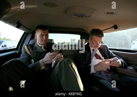Former Chief of Staff to the Vice President David Addington and Military Aide Tim Stefanick Type on Their BlackBerries - Stock Photo