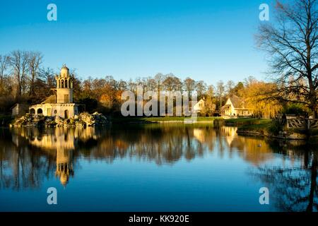 Palace of Versailles - Queen's Hamlet is a surprising beautiful setting. Its landscape and garden was dressed with - Stock Photo