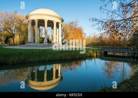 Palace of Versailles - Queen's Hamlet is a surprising beautiful setting. Lovely French garden architecture. - Stock Photo