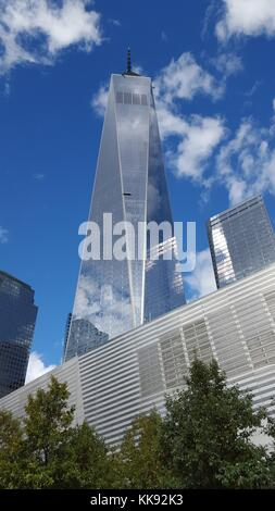 A photograph of the exterior of One World Trade Center and the National September 11 Museum, the tower is the mail - Stock Photo