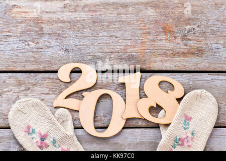 Cut out wooden number 2018 and gloves. - Stock Photo