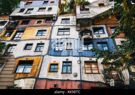 The view of facade of Hundertwasser house with multicolored walls in Vienna, Austria - Stock Photo