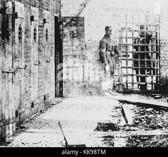 A photograph of the exterior of a slave pen, the pens themselves consist of narrow wooden doors with small holes - Stock Photo