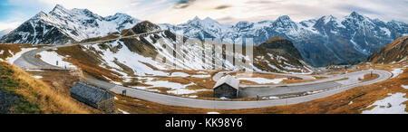 Panoramic view of Scenic High Alpine Road Pass in Austria or Grossglockner Hochalpenstrasse in autumn at sunset - Stock Photo