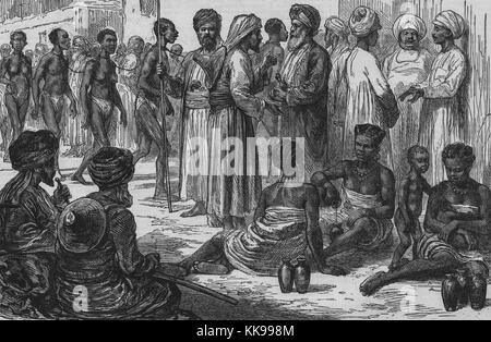 An etching that shows Arab slave dealers and slaves, the slaves are seen in two groups, the group on the left are - Stock Photo