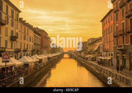 MILAN, ITALY, OCTOBER 13, 2017 - The Naviglio Grande canal at sunset in Milan, Italy - Stock Photo