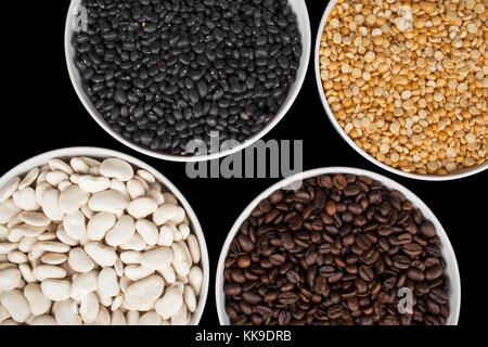 assorted beans in white bowl - Stock Photo