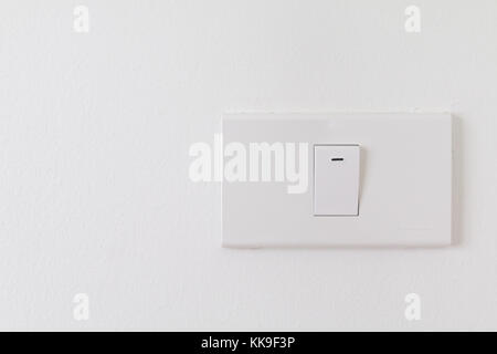 Electronic switches with white background, White switches on wall in home, Closeup switches interior - Stock Photo