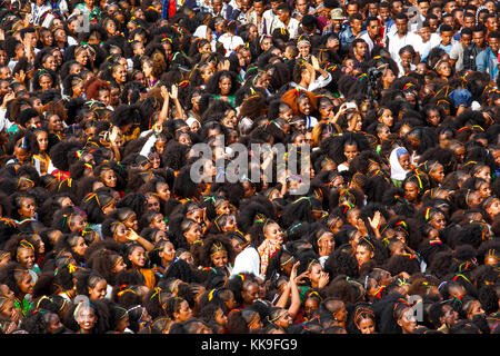 Crowd of women with Tigray style braided hair at Ashenda Festival, Mekele, Ethiopia. - Stock Photo