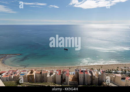 Beach of Postiguet and nearby buildings in the city of Alicante. - Stock Photo