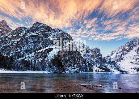 winter sunrise over Lago di Braies, Dolomites, Italy - Stock Photo