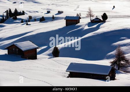 Winter sunrise over Alpe di Siusi Dolomites, Italy - Stock Photo