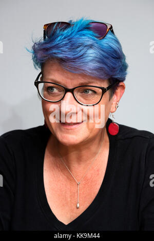 middle aged woman with dyed blue hair - Stock Photo