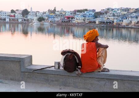 A Sadhu (holy man) at the sacred Pushkar Lake, Rajasthan,India - Stock Photo