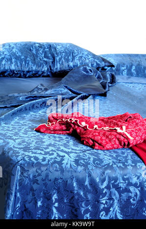 Woman on red silk sheets stock photo. Image of female