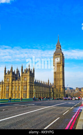 London, UK- February 6, 2017 : View of the Houses of Parliament from Westminster Bridge in London with city bus - Stock Photo