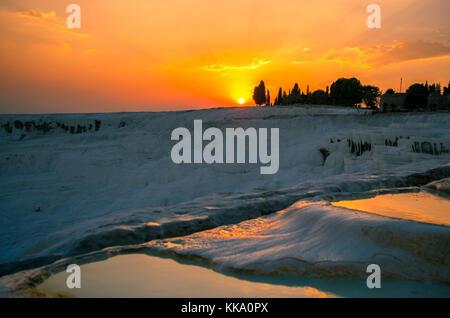 Sunset over the travertines of Pamukkale, Turkey - Stock Photo
